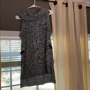 Black and white sleeveless sweater.
